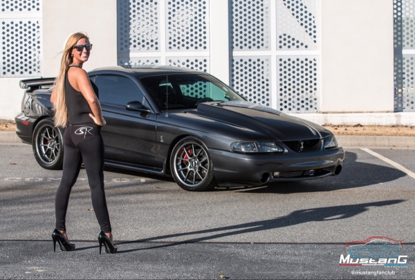 Olivia Hart with Chris Alfieri's 1998 Mustang